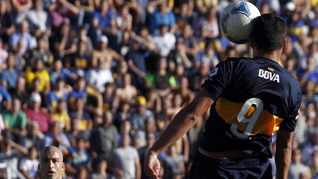 Boca Juniors' Lucas Viatri (R) scores a goal as teammate Santiago Silva watches during their Argentine First Division soccer match against Atletico Rafaela in Buenos Aires (Reuters)