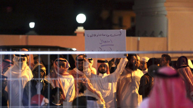 "Bahraini protesters chant slogans and one holds a banner that reads, ""none of our customs and traditions allow us to receive stars of porn movies,"" referring to TV star Kim Kardashian, in Riffa, Bahrain, Dec. 1, 2012. Just hours after reality TV star Kim Kardashian gushed about her impressions of Bahrain, riot police fired tear gas to disperse more than 50 hardline Islamic protesters denouncing her presence in the Gulf kingdom .(AP Photo/Hasan Jamali)"
