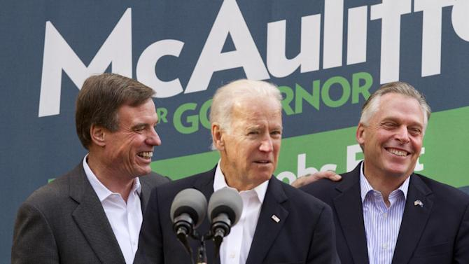 Vice President Joe Biden, center, accompanied by Sen. Mark Warner, D-Va., left, speaks at a campaign event for Virginia Democratic gubernatorial candidate Terry McAuliffe, right, Monday, Nov. 4, 2013, in Annandale, Va. On Tuesday, Virginia voters go to the polls to choose between McAuliffe and Ken Cuccinelli for the next governor. (AP Photo/Jacquelyn Martin)