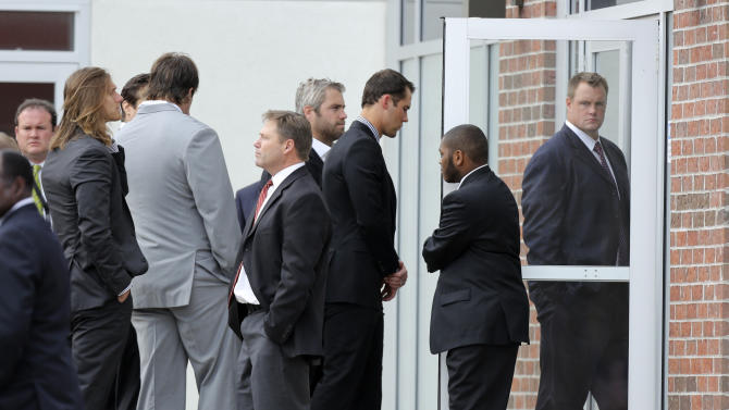 Kansas City Chiefs quarterback Matt Cassel, center, arrives at a memorial service for Kansas City Chiefs' Jovan Belcher at the Landmark International Deliverance and Worship Center Wednesday, Dec. 5, 2012 in Kansas City, Mo. Belcher shot and killed his girlfriend Kasandra Perkins at her home last Saturday, then drove to the Chiefs' practice facility and took his own life. (AP Photo/Ed Zurga)