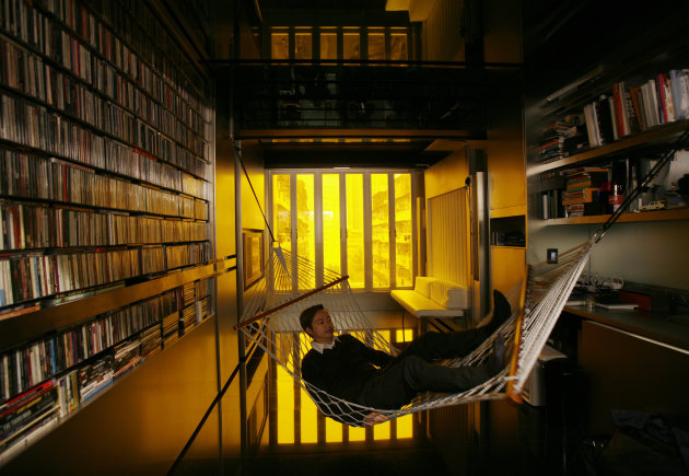 Hong Kong architect Gary Chang rests in a hammock inside his 32-square-metre apartment in Hong Kong