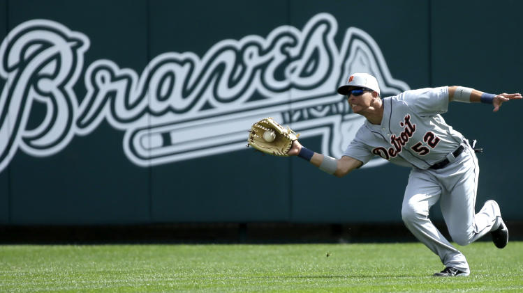 Detroit Tigers center fielder Quintin Berry catches a fly ball hit by Atlanta Braves' Justin Upton during an exhibition baseball game, Friday, Feb. 22, 2013, in Kissimmee, Fla. (AP Photo/David J. Phillip)