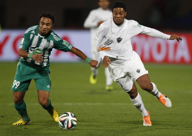 Raja Casablanca's Erraki fights for the ball with Atletico Mineiro's Ronaldinho during their FIFA Club World Cup semi-final soccer match at Marrakech stadium