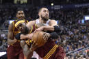 Cleveland Cavaliers' LeBron James (23) is fouled Toronto Raptors' Jonas Valanciunas during the second half of an NBA basketball game Wednesday, March 4, 2015, in Toronto. (AP Photo/The Canadian Press, Frank Gunn)