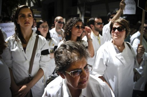&lt;p&gt;Hundreds of doctors in white smocks took to the streets of the Portuguese capital Wednesday, the first day of a two-day nationwide strike over sweeping austerity cuts to the health budget.&lt;/p&gt;