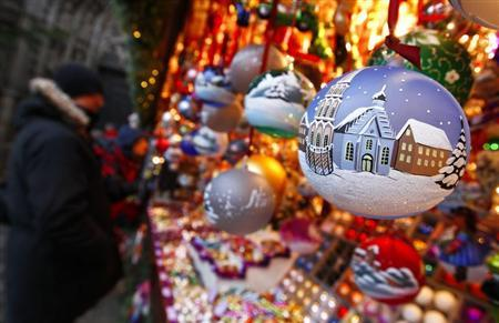 Christ Child Market guests look at traditional Christmas tree ball ornaments at opening day of Germany's oldest Christkindlesmarkt in Nuremberg