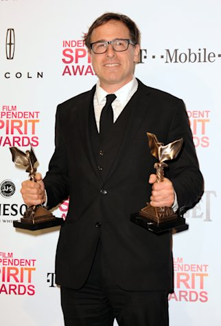 "Director David O. Russell poses backstage with the awards for best director and best screenplay for ""Silver Linings Playbook"" at the Independent Spirit Awards on Saturday, Feb. 23, 2013, in Santa Monica, Calif. (Photo by Jordan Strauss/Invision/AP)"