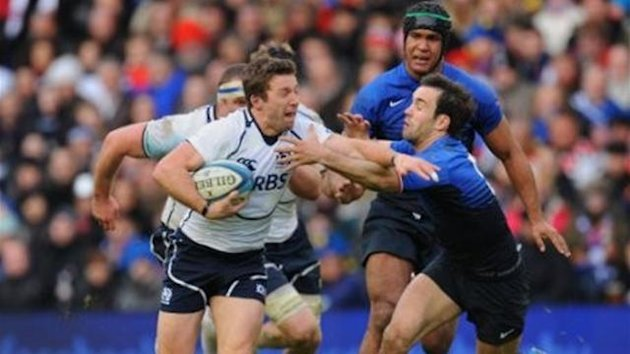 Scotland's Chris Cusiter (left) is tackled by France's Morgan Parra
