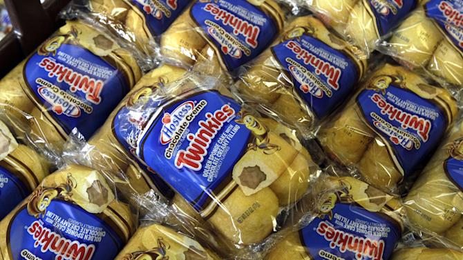 FILE - In this Friday, Nov. 16, 2013, file photo, Twinkies baked goods are displayed for sale at the Hostess Brands' bakery in Denver, Colo. Hostess Brands is close to announcing that it has picked two investment firms, C. Dean Metropoulos & Co. and Apollo Global Management,  as the lead bidders for its Twinkies and other snack cakes, according to a source close to the situation. (AP Photo/Brennan Linsley, File)