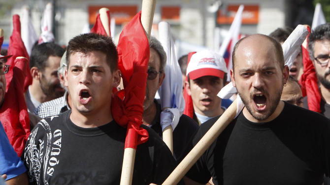 Protesters shout slogans outside the Greek parliament, Athens, during a 24-hour nationwide general strike on Thursday, Oct. 18, 2012. Greece was facing its second general strike in a month Thursday as workers protested over another batch of austerity measures that are designed to prevent the bankruptcy of the country. (AP Photo/Nikolas Giakoumidis)