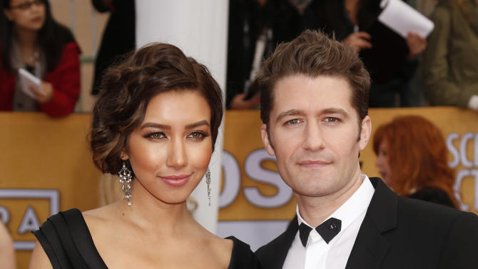 Renee Puente and Matthew Morrison arrive at the 19th Annual Screen Actors Guild Awards at the Shrine Auditorium in Los Angeles on Sunday Jan. 27, 2013. (Photo by Todd Williamson/Invision for The Hollywood Reporter/AP Images)