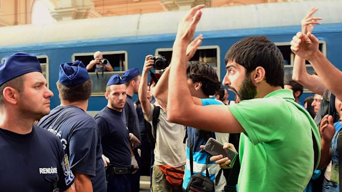 Migrants protest at Keleti railway station in Budapest on September 1, 2015, during its evacuation by local police