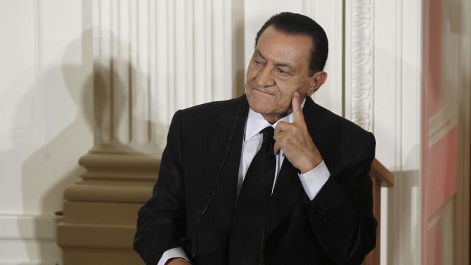"FILE - In this Wednesday, Sept. 1, 2010 file photo, Egypt's then President Hosni Mubarak listens as Israel's Prime Minister Benjamin Nethanyahu, unseen, speaks in the East Room of the White House in Washington. Ousted Egyptian President Hosni Mubarak may have cancer, his defense lawyer said Monday,  June 20, 2011 citing ""evidence suggesting"" the 83-year-old is sick with stomach cancer. (AP Photo/Charles Dharapak, File)"