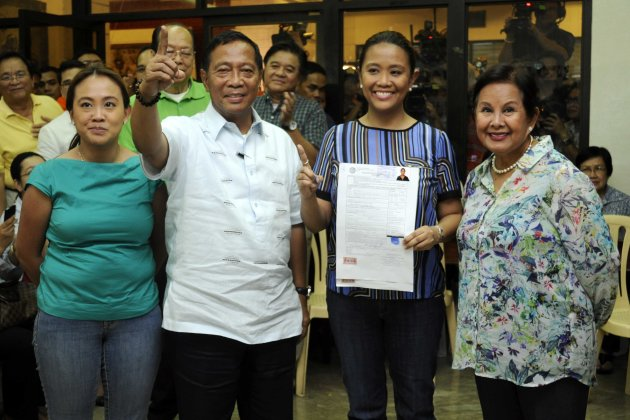 Vice President Jejomar Binay's eldest daughter Nancy files her certificate of candidacy with her family at the Commission on Election office in Intramuros, Manila Oct. 5. She was joined her father, mother Elenita and her sister, Makati City Rep. Mar-Len Abigail Binay-Campos. (Angela Galia, NPPA images)