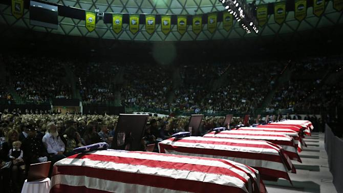 Caskets sit in front of the stage of a memorial for firefighters who were killed in the West, Texas, fertilizer plant explosion before President Barack Obama arrives, Thursday, April 25, 2013, at Baylor University in Waco,Texas. (AP Photo/Charles Dharapak)
