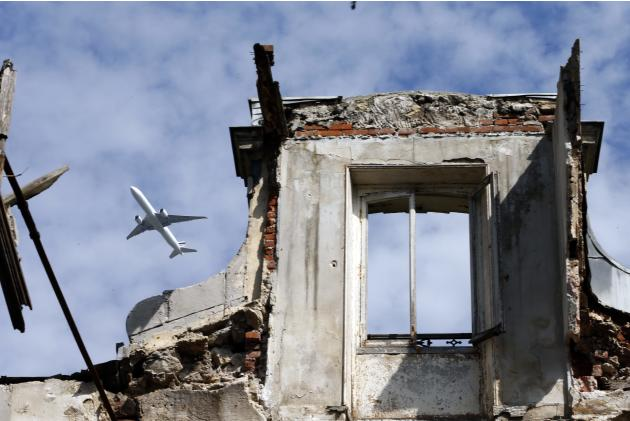 A commercial airplane flies over an abandoned 19th century manor in Goussainville-Vieux Pays. The ruin of the town is owed equally to modernisation and tragedy. In 1973, during the Paris Air Show, an