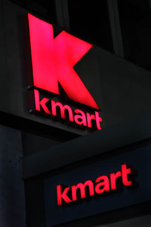 FILE - This Nov. 9, 2011 file photo, shows signs at a Kmart store, in New York. Kmart, a division of Sears Holdings Corp., said Friday, Sept. 7, 2012, that it's waiving the fees that shoppers pay to open its interest-free pay-over-time program at its discount stores and online through  Nov. 17. (AP Photo/Mark Lennihan, File)