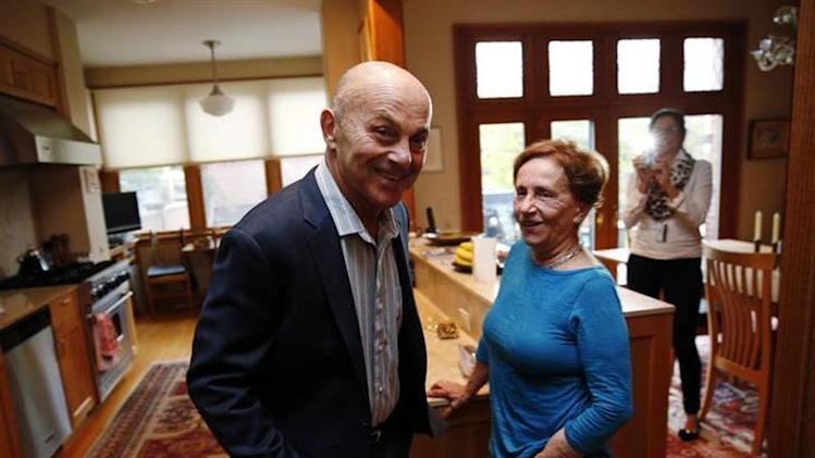 University of Chicago Professor Eugene Fama is pictured in his house with his wife Sally after finding out he won the 2013 Nobel Prize in Economics in Chicago, Illinois October 14, 2013.