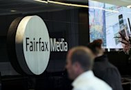 A man walks past signage in the foyer of the Sydney office of Fairfax Media on June 18. Mining magnate Gina Rinehart laid down an ultimatum to the chairman of troubled Australia media giant Fairfax -- meet a number of performance targets or resign