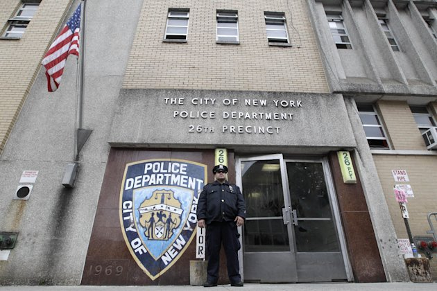 A police officer stands guard outside the 26th precinct where police officer Gilberto Valle worked out of, Thursday, Oct. 25, 2012 in New York. Valle was charged Thursday in a ghoulish plot to kidnap and torture women and then cook and eat their body parts. (AP Photo/Mary Altaffer)