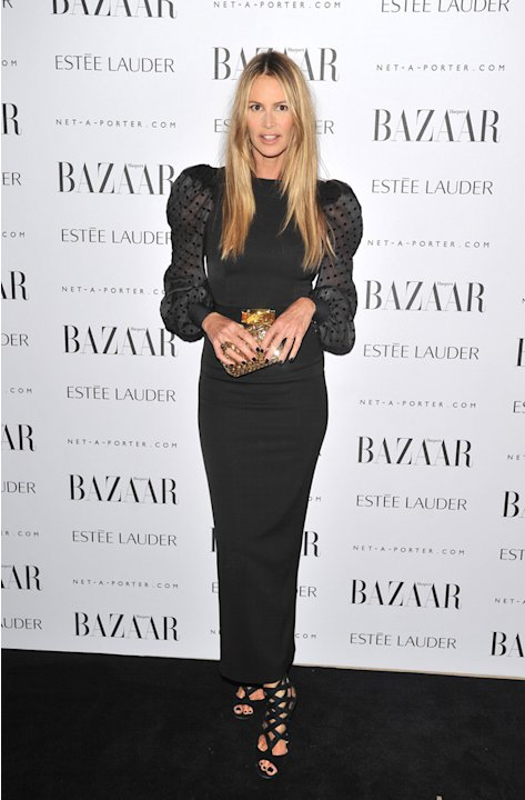 Supermodel Elle Macpherson accentuated her shoulders in her black outfit.