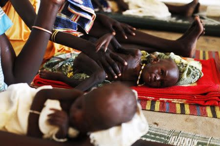 Malnourished children lay next to their mothers at the Medecins Sans Frontieres (MSF) hospital in Leer