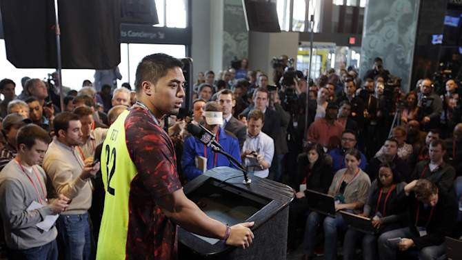Notre Dame linebacker Manti Te'o answers a question during a news conference at the NFL football scouting combine in Indianapolis, Saturday, Feb. 23, 2013. (AP Photo/Michael Conroy)
