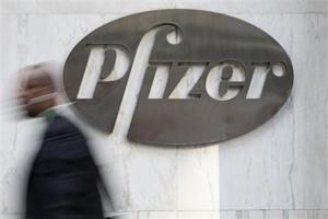 A man walks past Pfizer's world headquarters in New York
