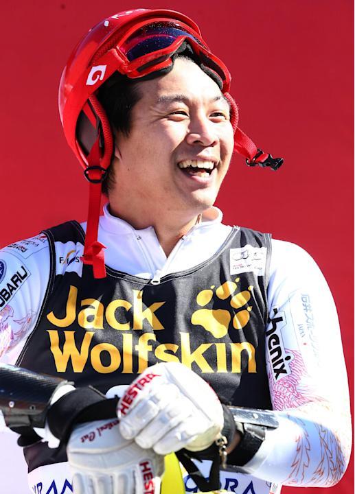 Japan's Akira Sasaki smiles in the finish area after completing an alpine ski, men's World Cup slalom, in Kranjska Gora, Slovenia, Sunday, March 9, 2014