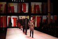 Models present creations by French designer Jean Paul Gaultier as part of his Fall-Winter 2013/2014 women's ready-to-wear fashion show during Paris fashion week March 2, 2013. REUTERS/Benoit Tessier