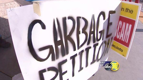 Clerks work to verify signatures on garbage petitions