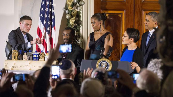 President Obama, first lady Michelle Obama, Rabbi Buchdahl, Dr. Levine and Tesfaye at Hanukkah reception at the White House