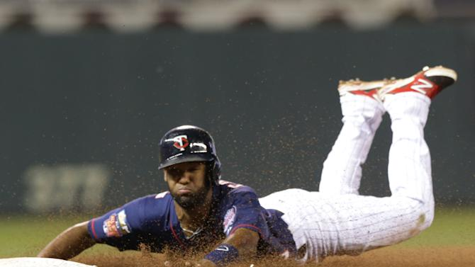 Minnesota Twins' Danny Santana advances to third on a single by Brian Dozier in the 10th inning of a baseball game against the Cleveland Indians, Friday, Sept. 19, 2014, in Minneapolis. Santana scored the winning run on a single by Trevor Plouffe as the Twins defeated the Indians 5-4. (AP Photo/Jim Mone)