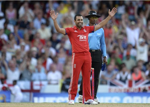 England's Bopara celebrates after dismissing West Indies' Gayle during the second T20 international cricket match in Bridgetown