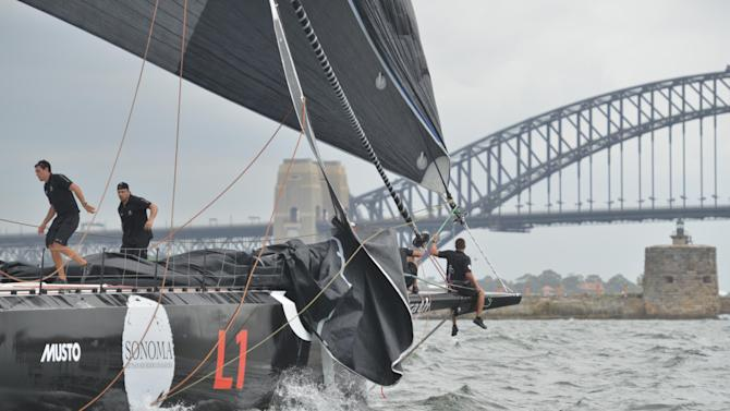 Australian supermaxi yacht Perpetual Loyal limps into the finish after a malfunction during the SOLAS Big Boat Challenge on Sydney Harbour, on December 9, 2014