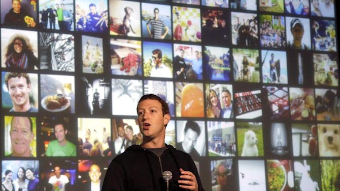 FILE - In this Tuesday, Jan. 15, 2013, file photo, Facebook CEO Mark Zuckerberg speaks at Facebook headquarters in Menlo Park, Calif. Facebook reports fourth-quarter earnings on Wednesday, Jan. 30, 2013. (AP Photo/Jeff Chiu, File)