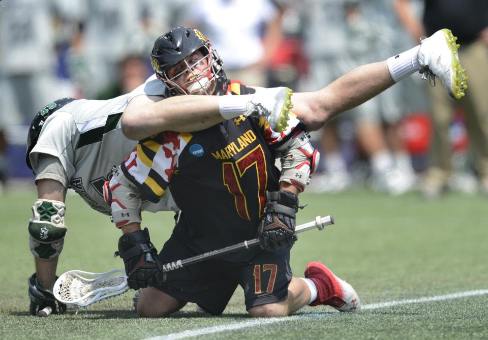 Loyola's J.P. Dalton, left, gets tangled with Maryland's Curtis Holmes during the first quarter of their Division I NCAA men's lacrosse championship game at Gillette Stadium in Foxborough, Mass., Monday, May 28, 2012. (AP Photo/Gretchen Ertl)