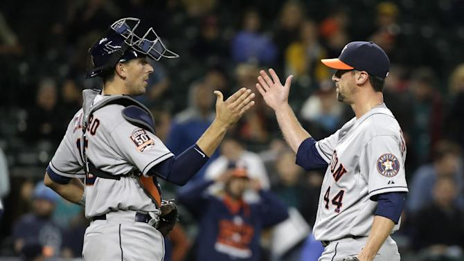 Houston Astros closing pitcher Luke Gregerson (44) and catcher Jason Castro share congratulations after the team beat the Seattle Mariners in a baseball game Monday, April 20, 2015, in Seattle. The Astros won 7-5. (AP Photo/Elaine Thompson)