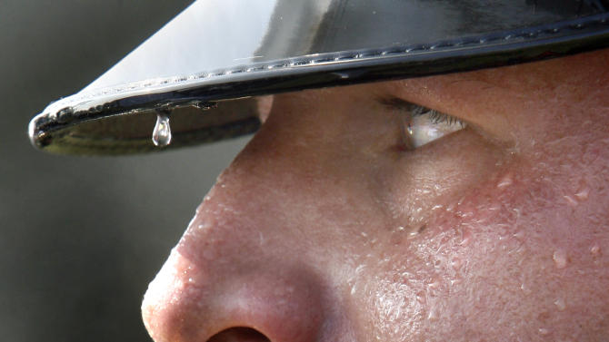 A bead of sweat rolls off the rim of the hat of U.S. Marine Cpl. William Woods of Glen Allen, Va.  as he awaits instuction from the leader of the Quantico Marine Corps Band at Manassas Battlefield Park, Thursday, July 21, 2011.  The band performed in extreme heat during the 150th Anniversary First Battle of Manassas commemorative program. (AP Photo/Richmond Times-Dispatch, P. Kevin Morley)  MANDATORY CREDIT