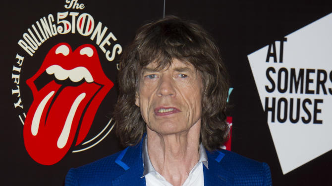 Mick Jagger from the British Rock band, The Rolling Stones, arrives at a central London venue, to mark the 50th anniversary of the Rolling Stones first performance, Thursday, July 12, 2012. (AP Photo/Jonathan Short)