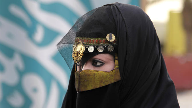 FILE - In this Friday, April 29, 2011 file photo, a Saudi woman attends a traditional Arda dance, or War dance, during the Janadriyah Festival of Heritage and Culture, on the outskirts of the Saudi capital Riyadh, Saudi Arabia. Saudi King Abdullah has given the kingdom's women the right to vote for first time in nationwide local elections, due in 2015. The king said in an annual speech on Sunday, Sept. 25, 2011 before his advisory assembly, or Shura Council, that Saudi women will be able to run and cast ballots in the 2015 municipal elections. (AP Photo/Hassan Ammar, File)