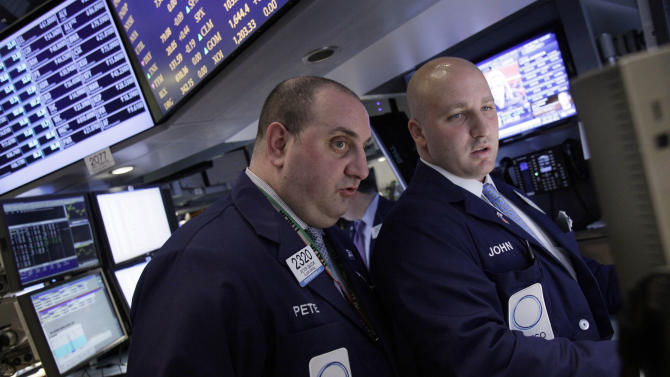 Specialists Peter Giacchi, left, and John Parisi confer on the floor of the New York Stock Exchange Wednesday, April 25, 2012.  U.S. stocks were headed for a neutral opening, with Dow Jones industrial futures nearly unchanged.  (AP Photo/Richard Drew)