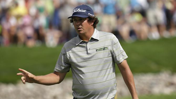 Jason Dufner celebrates after a birdie on the 11th hole during the second round of the PGA Championship golf tournament at Oak Hill Country Club, Friday, Aug. 9, 2013, in Pittsford, N.Y. (AP Photo/Charlie Neibergall)