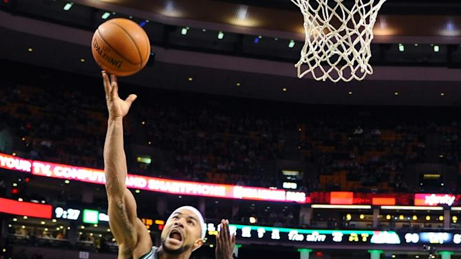 Bayless, Rondo lead Celtics past Hawks 115-104
