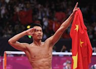 LONDON, ENGLAND - AUGUST 05:  Lin Dan of China celebrates winning his Men&#39;s Singles Badminton Gold Medal match against Chong Wei Lee of Malaysia on Day 9 of the London 2012 Olympic Games at Wembley Arena on August 5, 2012 in London, England.  (Photo by Michael Regan/Getty Images)