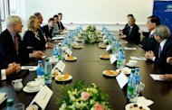 US Secretary of State Hillary Clinton (2nd L) during a bilateral meeting with Taiwanese special envoy Lien Chan (2nd L) at the APEC summit in Russia on September 9. A draft of the statement to be released after the summit reflected worries over the impact of Europe's debt crisis on growth in the APEC region