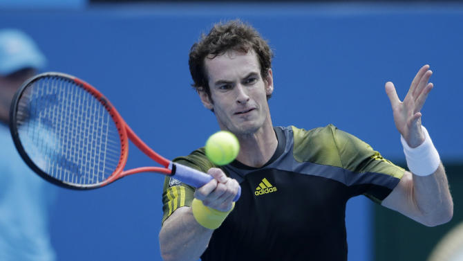 Britain's Andy Murray hits a forehand return to France's Gilles Simon during their fourth round match at the Australian Open tennis championship in Melbourne, Australia, Monday, Jan. 21, 2013. (AP Photo/Rob Griffith)
