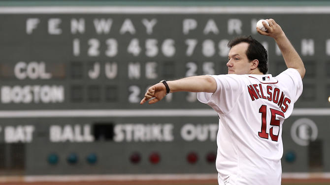 FILE - In a Tuesday, June 25, 2013 file photo, Andris Nelsons, who was recently appointed as music director of the Boston Symphony Orchestra, reacts after throwing out the first pitch before a baseball game between the Boston Red Sox and the Colorado Rockies at Fenway Park in Boston. Nelson has canceled a weekend appearance at Tanglewood after suffering a concussion following a freak accident in Germany. He'd been scheduled to conduct the Verdi Requiem on Saturday, July 27 at Tanglewood, the BSO's summer home in Lenox, Mass. The Boston Globe reported that Nelsons recently collided with a door that unexpectedly swung open at his residence in Bayreuth, Germany. He was still hospitalized Monday and doctors have advised him against plane travel. (AP Photo/Winslow Townson, File)