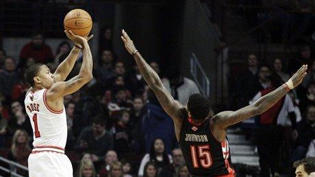 Rose leads Bulls to 77-64 win over Raptors