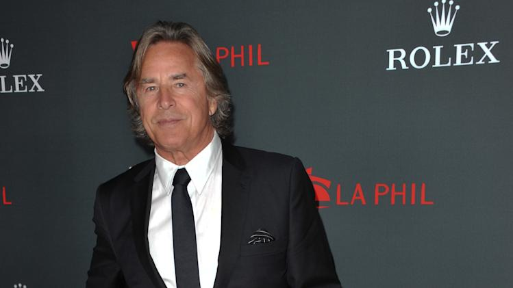 "FILE - In this Thurs., Sept. 27, 2012 file photo, Don Johnson arrives at the Los Angeles Philharmonic's 2012 Opening Night Gala, in Los Angeles. An appeals court on Monday Oct. 1, 2012 trimmed Johnson's $23.2 million verdict over ""Nash Bridges"" profits down to $15 million plus interest after determining that jurors mistakenly awarded Johnson interest in their original verdict. (Photo by Richard Shotwell/Invision/AP, File)"